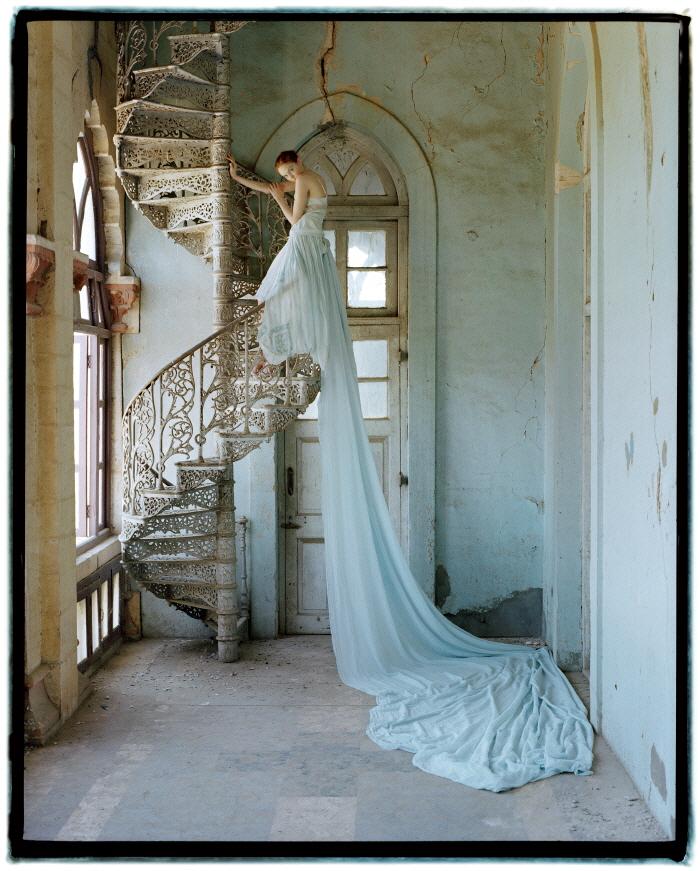 Tim Walker_Lily Cole on Spiral Staircase, Whadwan, Gujarat, India, 2005_ⓒ Tim Walker.jpg