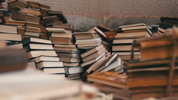 depositphotos_122469816-stock-video-stack-of-books-scattered-on.jpg
