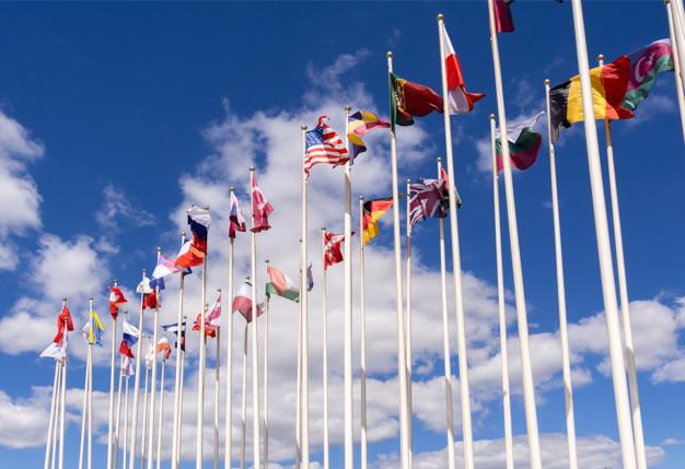 national-flags-masts-flags-united-states-germany-belgium-italia-israel-turkey_73101-169.jpg