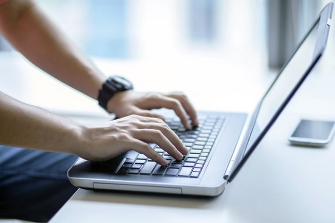 Using-laptop-567730b05f9b586a9e5f2084.jpg