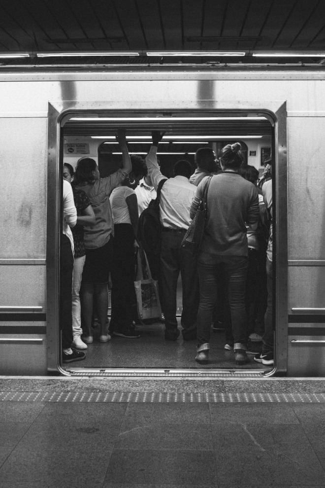 people-standing-inside-train-1970283.jpg