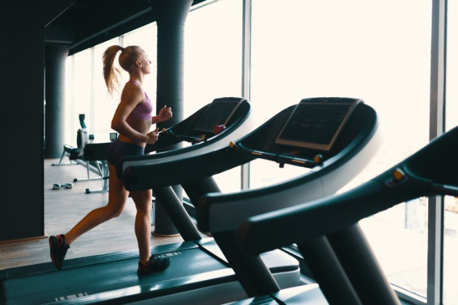 young-caucasian-woman-doing-exercise-with-dumbbells-while-training-arms-gym.jpg